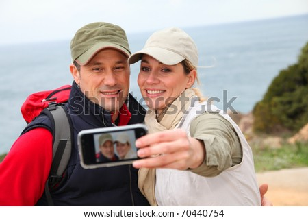Couple of hikers taking picture of themselves - stock photo