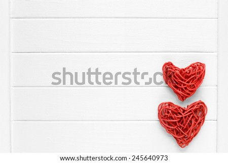 Couple of love red pedig rattan hearts on wooden light background - valentines - mothers day - fathers day - wedding invitation - card - space for text - stock photo