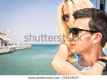 Couple of Lovers leaving for a romantic Boat Trip - stock photo