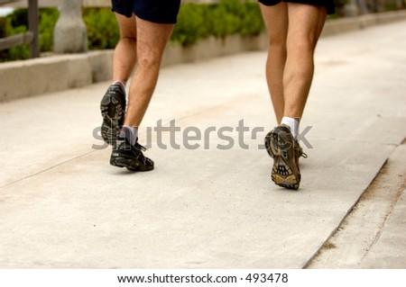 Couple of men running. - stock photo
