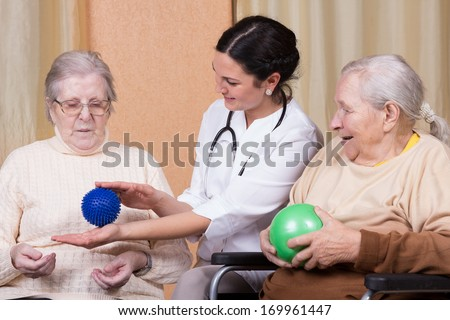 couple of senior Woman with physical therapists using fitness balls - stock photo