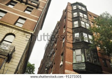 couple of tall old apartment building - stock photo