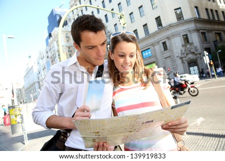 Couple of tourists in Gran Via avenue of Madrid - stock photo