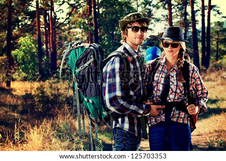 Couple of tourists on a trekking trail. - stock photo