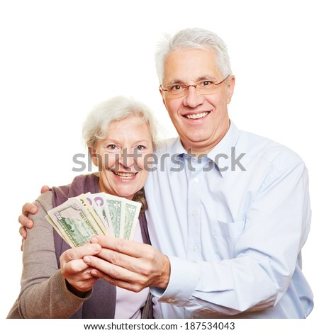 Couple of two happy senior people holding dollar bills in their hands - stock photo