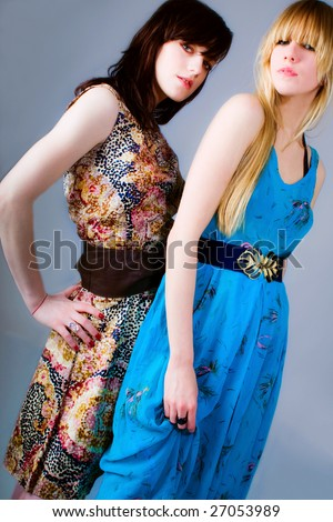 couple of young women in retro summer clothes - stock photo