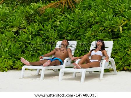 Couple on a beach - stock photo