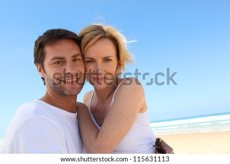Couple on a blue sky day - stock photo