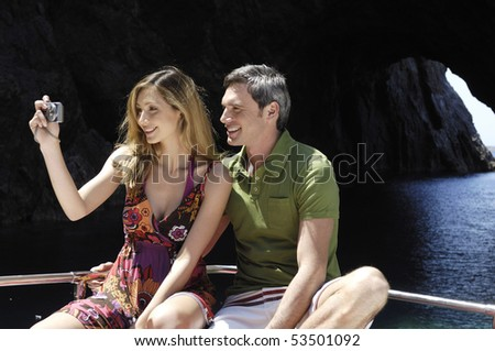 couple on a boat taking a picture - stock photo
