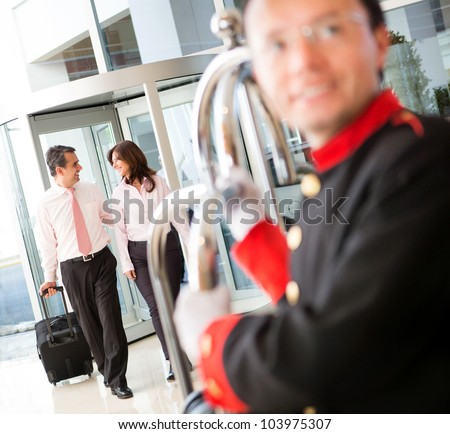 Couple on a business trip arriving to the hotel - stock photo