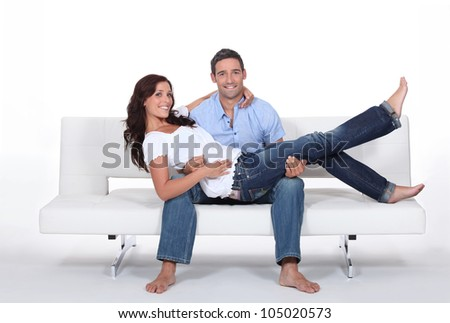 Couple on a couch - stock photo
