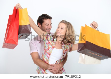 Couple on a spending spree - stock photo