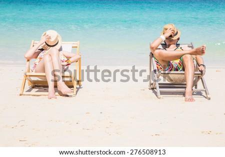 Couple on a tropical beach at Maiton island. - stock photo
