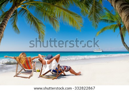 Couple on a tropical beach in the Maldives - stock photo