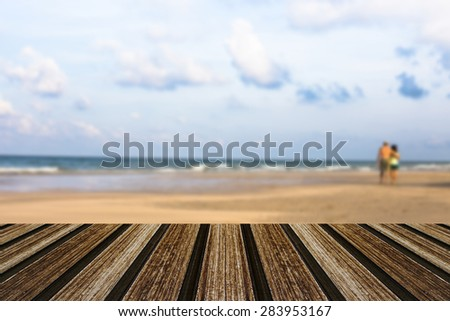 Couple on a tropical beach with wooden. for your photomontage or product display. - stock photo