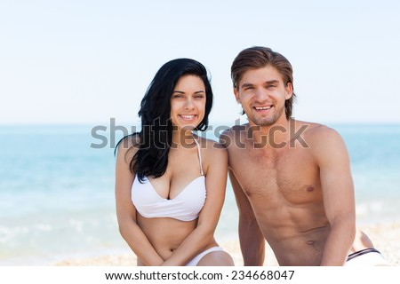 Couple on beach summer vacation, beautiful young happy couple love smiling man and woman over sea blue sky, concept ocean holiday travel - stock photo