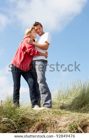 Couple on beach vacation - stock photo