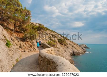 Couple on footpath - stock photo