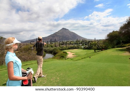 Couple on golf green - stock photo