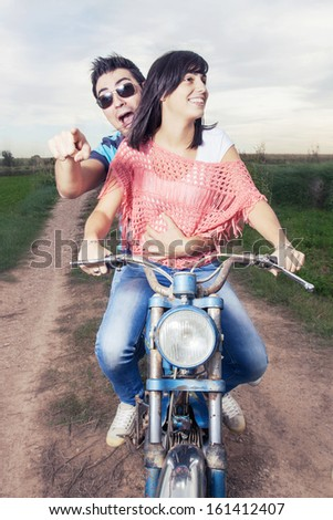 couple on motorcycle - stock photo