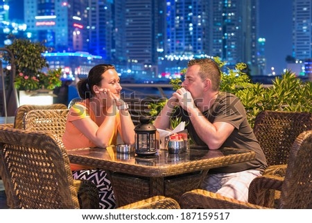 Couple on romantic dinner in outdoor city scenery - stock photo