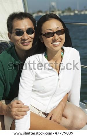 Couple on Sailboat - stock photo