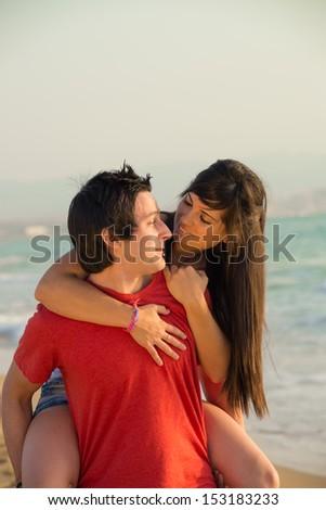 Couple on the beach enjoying vacation time - stock photo