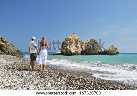 Couple on the beach near Aphrodite birthplace, Cyprus  - stock photo