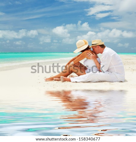 Couple on the beach of sea - stock photo