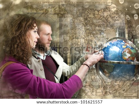 Couple on the date looking at the globe. Travel concept. - stock photo