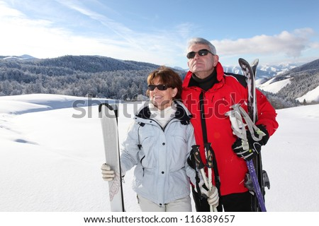 Couple out skiing together - stock photo