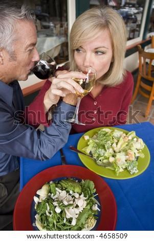 Couple outside feeding each other - stock photo