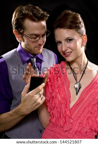 couple partying. black background - stock photo