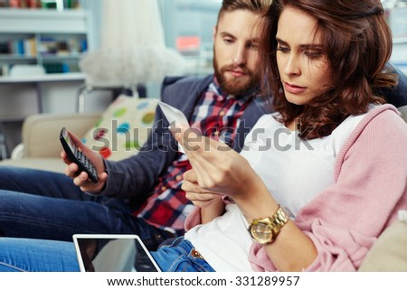 Couple paying bills with digital tablet - stock photo