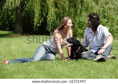 couple people with dog outdoor - stock photo