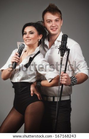 Couple performs duet singing microphone  - stock photo