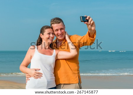 couple photographed in memory on the background of the sea - stock photo