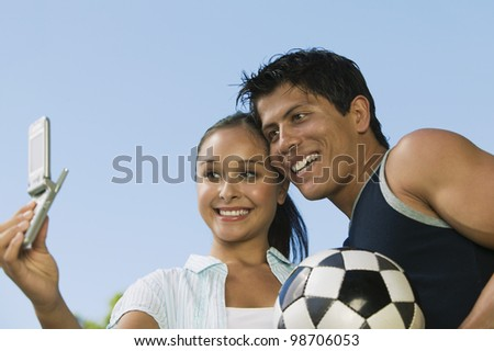 Couple Photographing Themselves with Cell Phone - stock photo