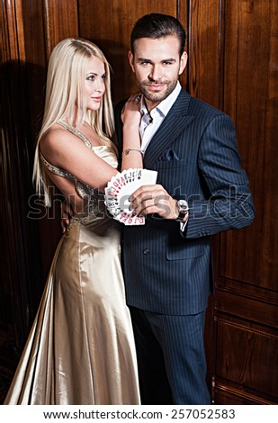 couple play and win in casino pocker - stock photo