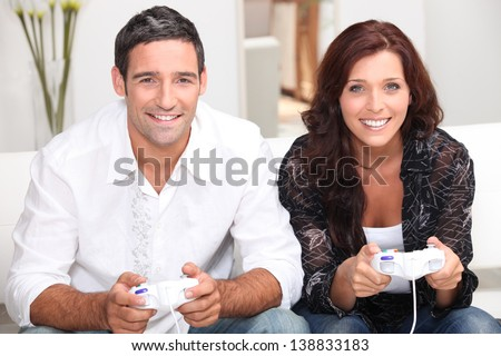 Couple playing video games - stock photo