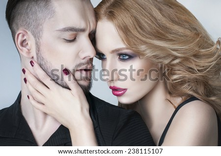 Couple portrait. Beautiful couple in love. Blond woman hugging a man. Valentine couple. Portrait of  beauty blond girl and her handsome boyfriend. Young family. Love. Lovers. Valentines Day - stock photo