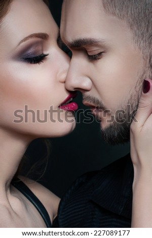 Couple portrait. Passionate couple in love.  Woman hugging a man. Valentine couple. Portrait of  beauty girl and her handsome boyfriend. Love. Kiss. Flirt.  Lovers. Valentines Day - stock photo