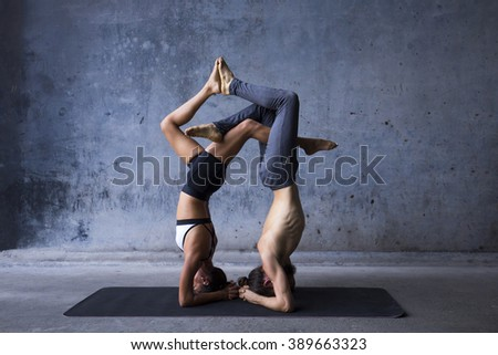 Couple practicing acroyoga together - stock photo