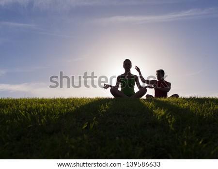 Couple practicing yoga. - stock photo