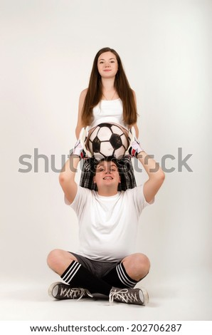 Couple. Pregnant with body art on her stomach - stock photo