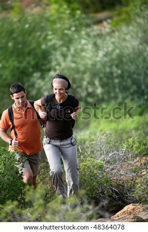 Couple rambling in countryside - stock photo