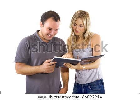 couple reading a book  together - stock photo