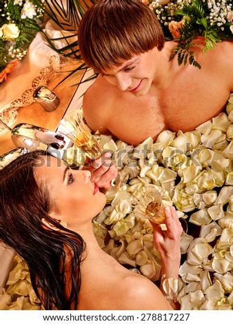 Couple relax  at luxury spa with white rose petals. - stock photo
