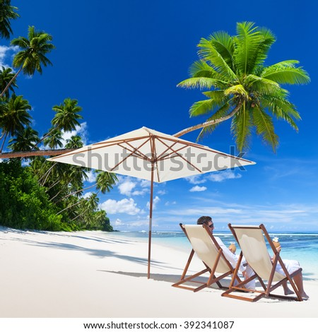 Couple Relaxation Vacation Summer Beach Holiday Concept - stock photo