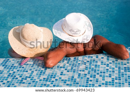 couple relaxing by the pool - stock photo